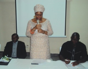 Special Adviser to Edo State Governor on Oil and Gas Matter, Princess (Mrs.) Ikuoyemwen Erediauwa Aimiuwu (middle) delivering her speech during a 2-day workshop organised by ANEEJ in Benin City. The Senior Special Adviser to Edo State Governor on Civil Society Comrade Efosa Kayode-Iyasere (left) and ANEEJ Programme Officer, Mr. Innocent Edemhauria (right) looks on. Photo: richard eweka